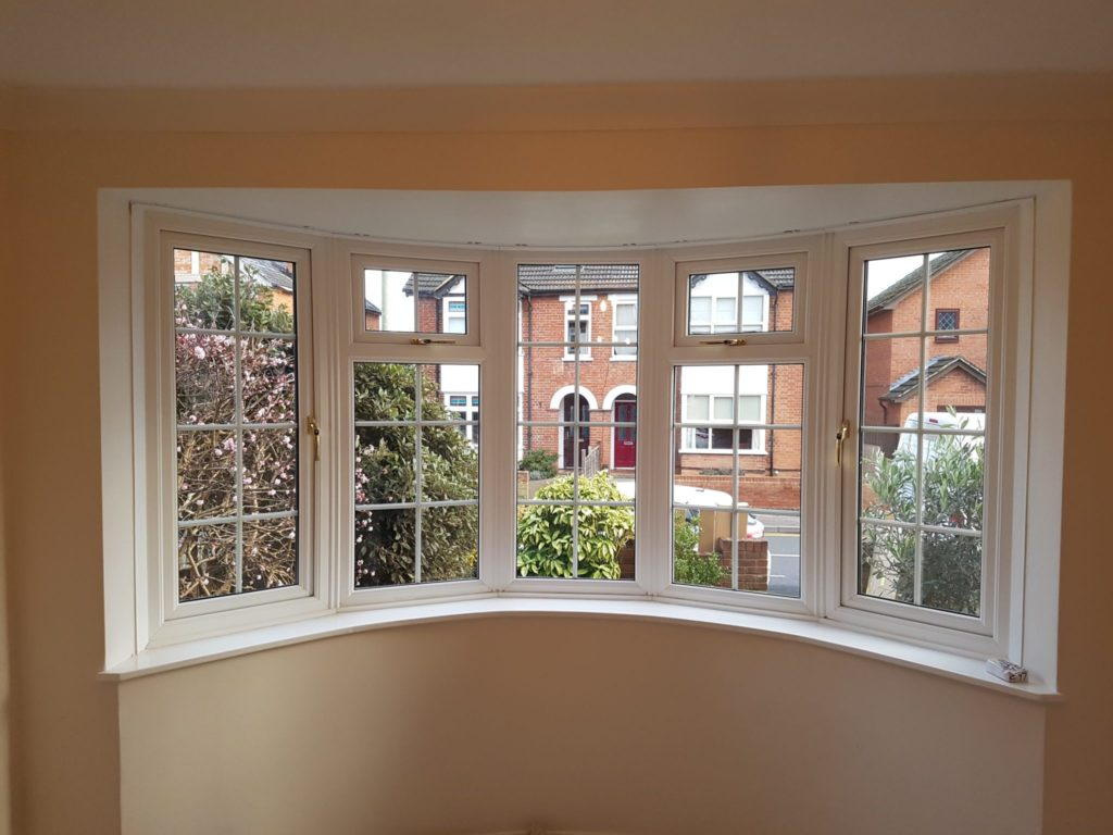 White Full Height Shutters For Bay Window Of Home In