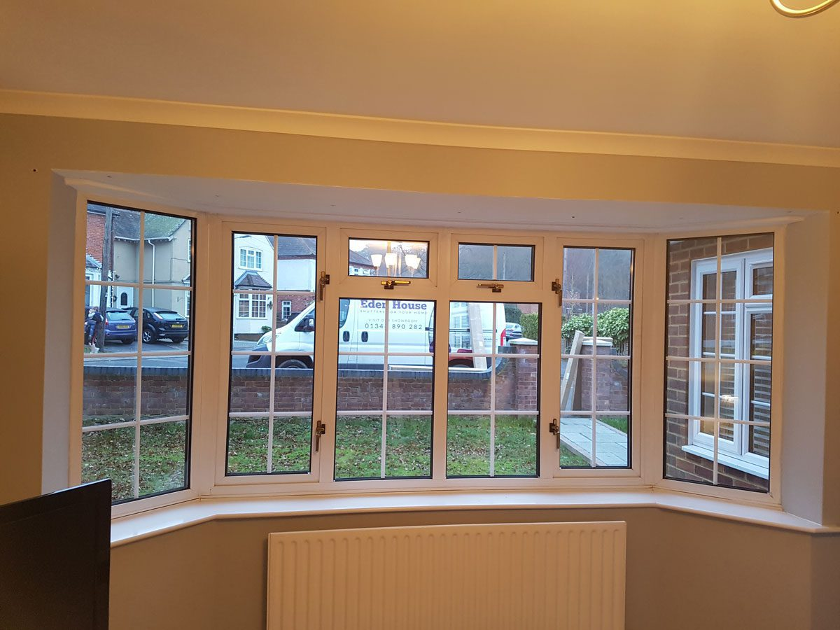 Plantation Shutters For Living Room Window And French Doors Of Home