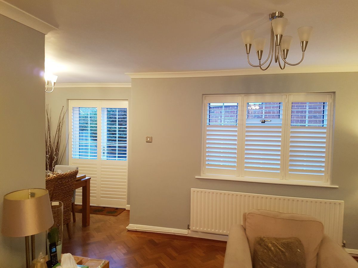 Plantation Shutters For Living Room Window And French Doors Of Home In Crowth